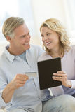 Couple With Digital Tablet And Credit Card Shopping Online Royalty Free Stock Photo