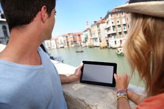 Couple with digital tablet on Rialto bridge Royalty Free Stock Photos
