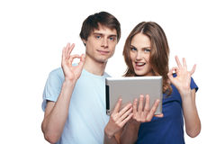 Couple with digital tablet showing OK signs Royalty Free Stock Photo