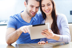 Couple with digital tablet Stock Photography