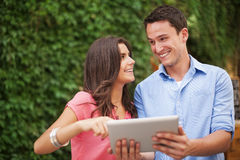 Couple with digital tablet Royalty Free Stock Photography