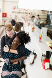 Couple in the diner. Couple hugging by the bar in the diner Royalty Free Stock Photos