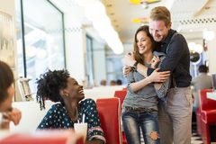 Couple in the diner. Couple hugging by the table in the diner Royalty Free Stock Image
