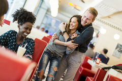 Couple in the diner. Couple hugging by the table in the diner Stock Photos