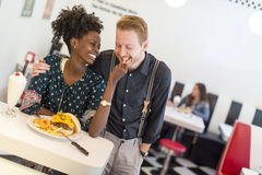 Couple in the diner. View of the young couple eating in the diner Royalty Free Stock Photos