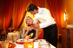 Couple dining in a fancy restaurant Royalty Free Stock Image