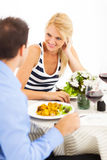 Couple dining out. Happy young couple dining out Royalty Free Stock Images
