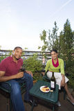 Couple Dining Outdoors Stock Image