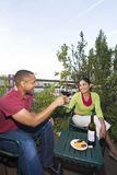 Couple Dining Outdoors Stock Photos