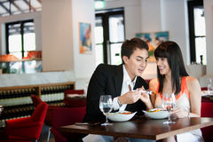 Couple Dining in Restaurant Royalty Free Stock Photography