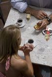 Couple dining in restaurant, man proposing to woman, elevated view Stock Photos