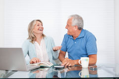 Couple At Dining Table Working on Laptop Royalty Free Stock Images