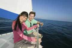 Couple dinking white wine on sailboat Stock Photography