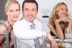 Couple at dinner party Royalty Free Stock Images
