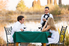 Couple dinner waitress Royalty Free Stock Images