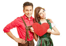 Couple in dirndl dress and leather Stock Photos