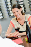Couple dirnking wine during meal Stock Images