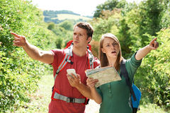 Couple Disagreeing About Best Way To Navigate On Hike. Couple Disagree About Best Way To Navigate On Hike Royalty Free Stock Photos