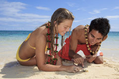 Couple discover a small crab Royalty Free Stock Image