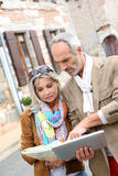 Couple discovering old town with tablet Stock Photography
