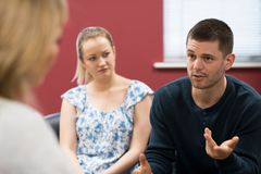 Couple Discussing Problems With Relationship Counselor. Couple Discuss Problems With Relationship Counselor royalty free stock image