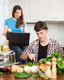 Couple discusses the new recipe Royalty Free Stock Image