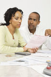 Couple Discussing Bill Royalty Free Stock Photo