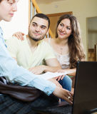 Couple discussing details of private insurance with agent Stock Photo