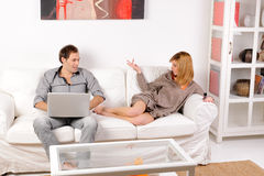 Couple discussing at home Stock Photography