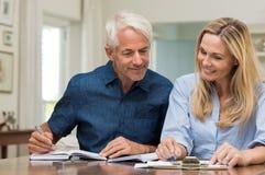 Couple discussing home economics stock image