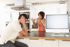 Couple Discussing Personal Finances In Kitchen Stock Photography