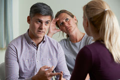 Couple Discussing Problems With Relationship Counsellor. Couple Discuss Problems With Relationship Counsellor stock photos