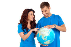 Couple discussing about specific country. While points at it. All on white background Stock Photo