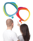 Couple discussing with speech bubbles Stock Images