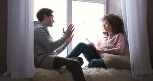Couple discussing and writing shopping list at home stock footage