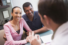 Couple in discussion with doctor in IVF clinic Stock Image