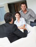 Couple in discussion with a financial advisor Stock Photography