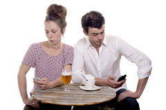 Couple Disgruntled at the terrace of a cafe Stock Images