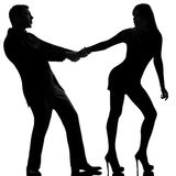 Couple dispute separation woman leaving man hold. One caucasian couple dispute separation women leaving and men holding back in studio silhouette isolated on Royalty Free Stock Photo
