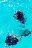 Couple divers in the open ocean on sunny day Stock Images