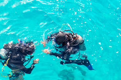 Couple divers plunged into the ocean, top view Stock Photo