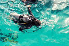 Couple divers plunged into the ocean, top view Royalty Free Stock Image