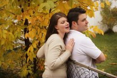 A couple divided by a fence Stock Images