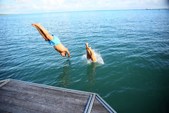 Couple diving to the sea stock image