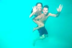 Couple diving underwater stock photos