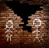 Couple divorce. Man and woman stick figures on broken brick wall -- divorce concept Royalty Free Stock Photo