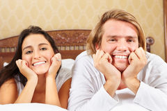 Couple do pose on bed Stock Images