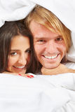 Couple do pose on bed Stock Image