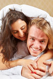 Couple do pose on bed Royalty Free Stock Images