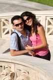 Couple do sightseeing in Athens. Young happy couple do sightseeing in Greek capital - city of Athens in a bright sunny day Stock Photography